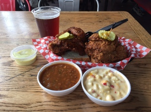 Two piece white meat with baked beans, pimento mac and cheese, and a Jackalope beer Hattie B's Nashville, TN
