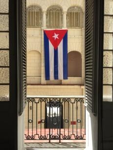 The courtyard inside the Museo de la Revolución and the Cuban flag