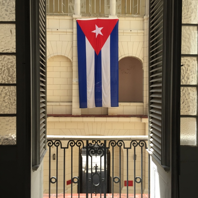 The courtyard inside the Museo de la Revolución and the Cuban flag