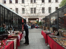Vendors line the sides of the walkway
