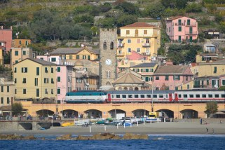 The Tren Italia train passing through Monterosso