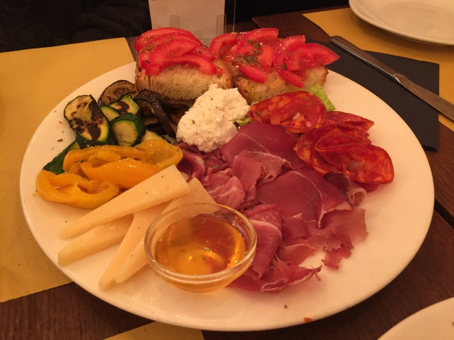 Traditional Italian starter plate with meats and vegetables