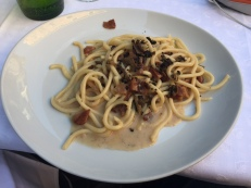 Pici with bacon, cheese, and black summer truffle