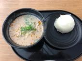 Delicious noodles and a pork bun