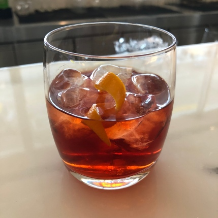 Sipping a negroni