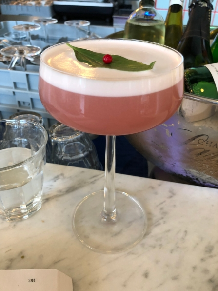 The Lavender Fields (gin, Benedictine, cranberry, lingonberries, lavender, and egg white)